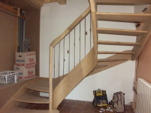Start of a stair in ash built with veneered laminates