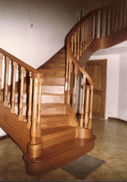 Elm stair built with horizontal laminates and solid wood rail