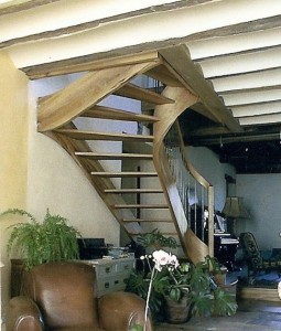 Elm stair in horizontal laminates with rail cut from the stringer