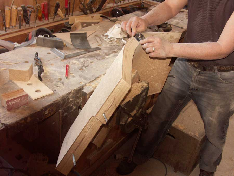 Hand smoothing a laminated stringer