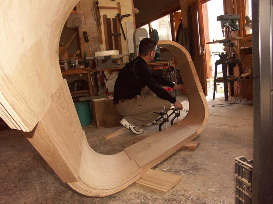 Marking out the final shape of a curved stringer in the workshop